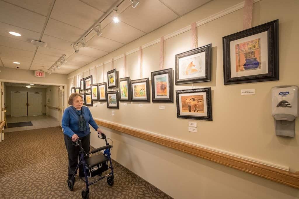 Seabury Woods Resident walking through gallery